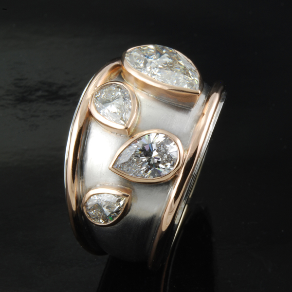 Pear Shaped Diamonds 18K Gold and 18K White Gold Ring